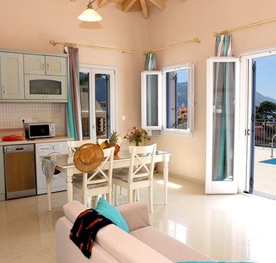 Dining and kitchen with French doors and view out into the bay, Villa Panorama, Assos, Kefalonia