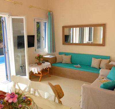 Comfortable lounge space with a view inside Villa Panorama, Assos, Kefalonia