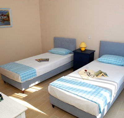 Bedroom with single beds inside Villa Panorama, Assos, Kefalonia
