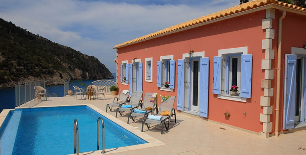 Colourful Villa Panorama, its pool and sun loungers, Assos, Kefalonia