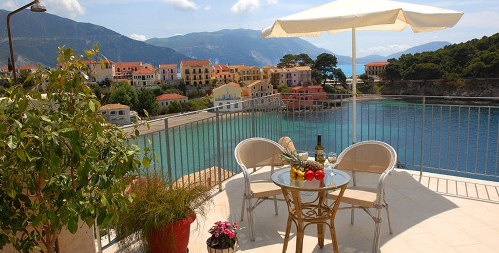 Fruit and wine make the perfect holiday lunch on the terrace outside Villa Panorama, Assos, Kefalonia