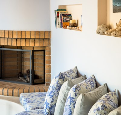Charismatic fireplace in lounge area at Villa Petrino, Assos, Kefalonia, Greek Islands