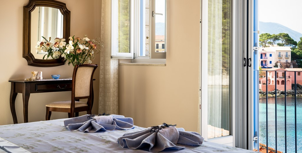 Tastefully decorated master bedroom with views overlooking Ionian Sea at Villa Petrino, Assos, Kefalonia, Greek Islands