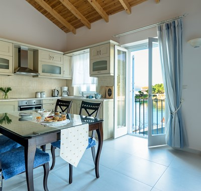 Full equipped kitchen diner with French doors to terrace at Villa Petrino, Assos, Kefalonia, Greek Islands