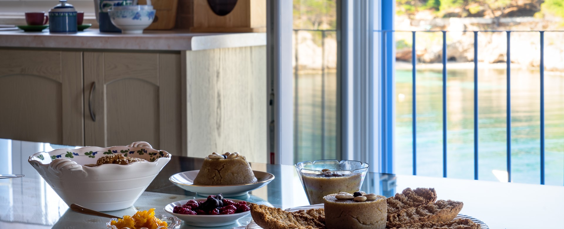 Breakfast indoors with waterfront view at Villa Petrino, Assos, Kefalonia, Greek Islands