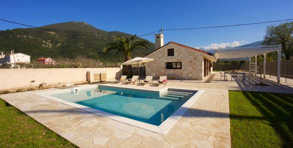 Spacious private pool with loungers and shaded terrace at Villa Theano, Sami, Kefalonia, Greek Islands