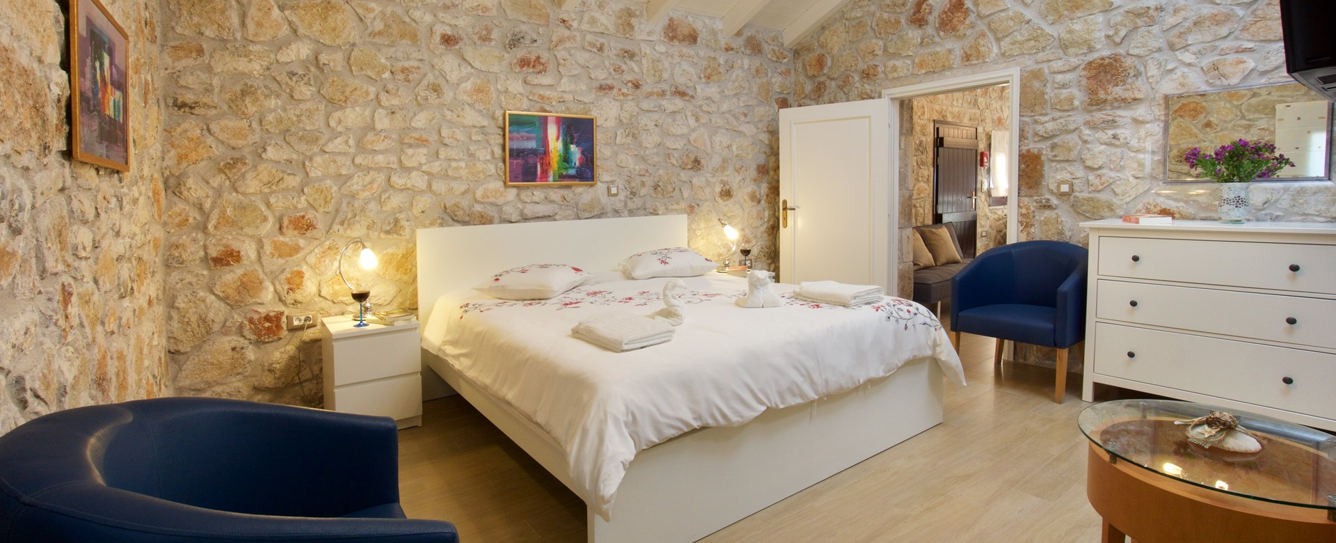 Exquisitely decorated master bedroom complete with characterful stone walls at Villa Theano, Sami, Kefalonia, Greek Islands