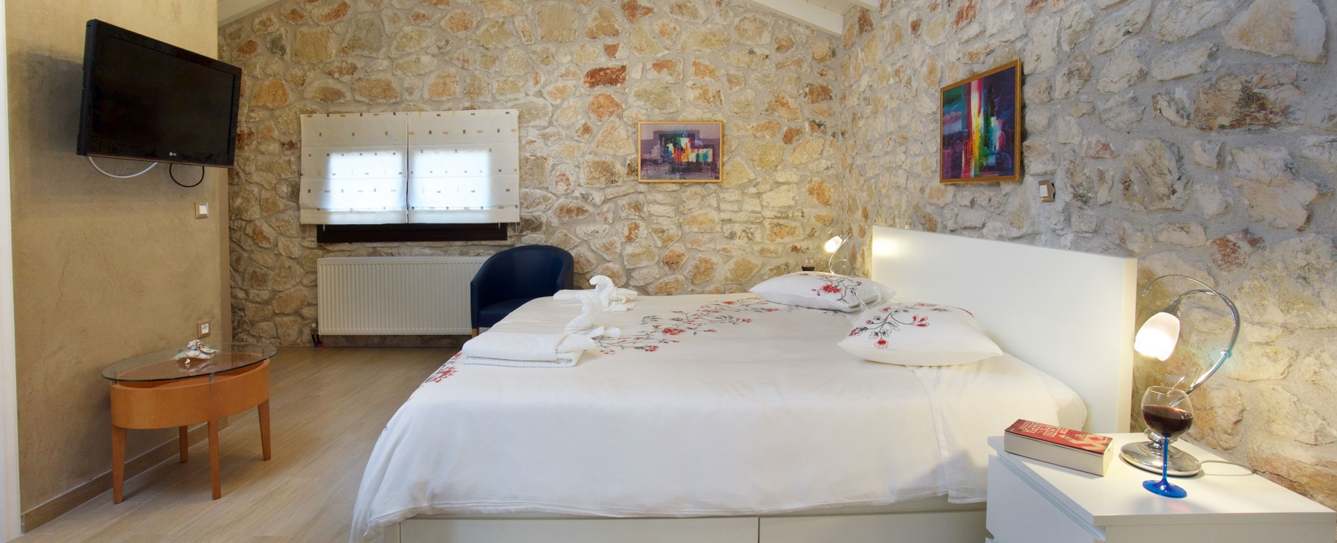 Gorgeous double bedroom with charming stone wall feature at Villa Theano, Sami, Kefalonia, Greek Islands