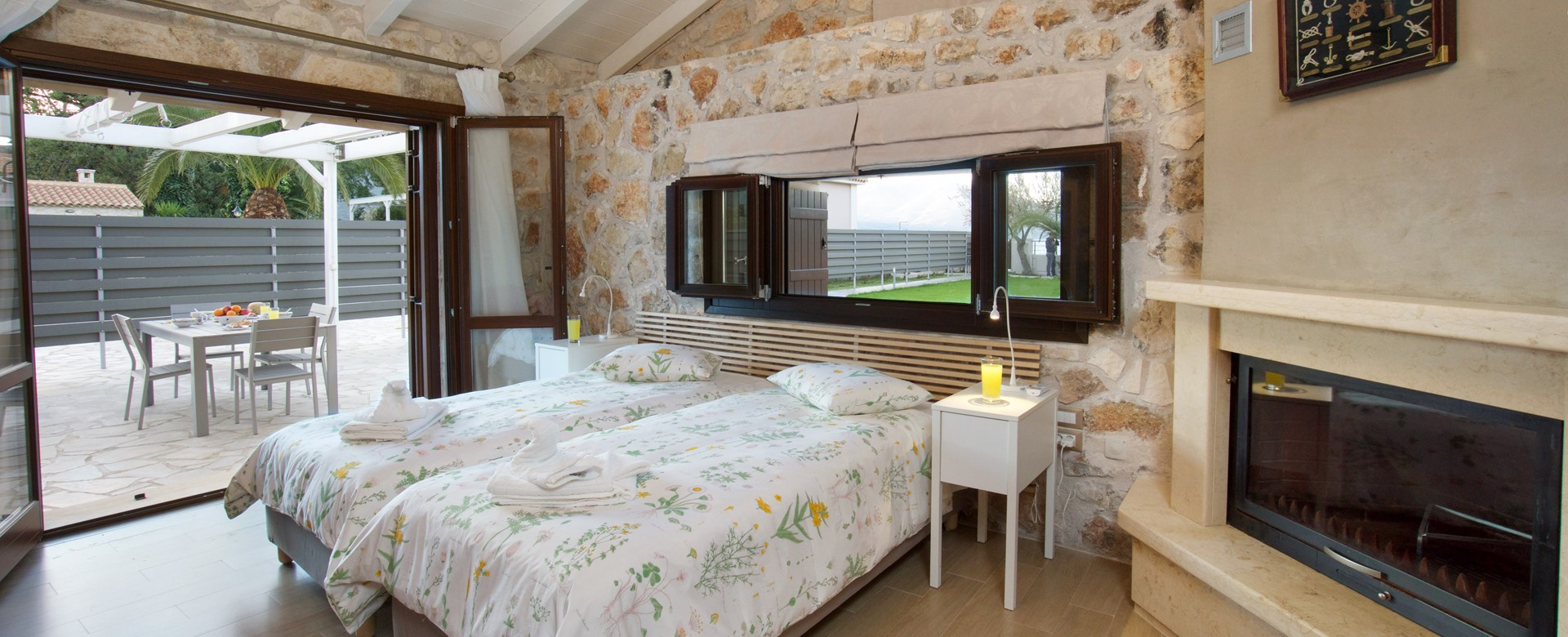 Exceptionally decorated twin room with bifold door access to outside terrace at Villa Theano, Sami, Kefalonia, Greek Islands