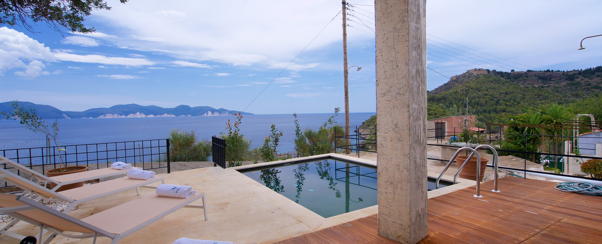 Decked veranda with pool and views out to the Mediteranean at Villa Vivere, Assos, Kefalonia