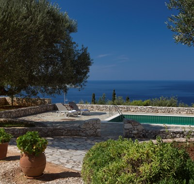 Pool, garden and sea views outside Lemoni Cottage, Fiscardo, Kefalonia