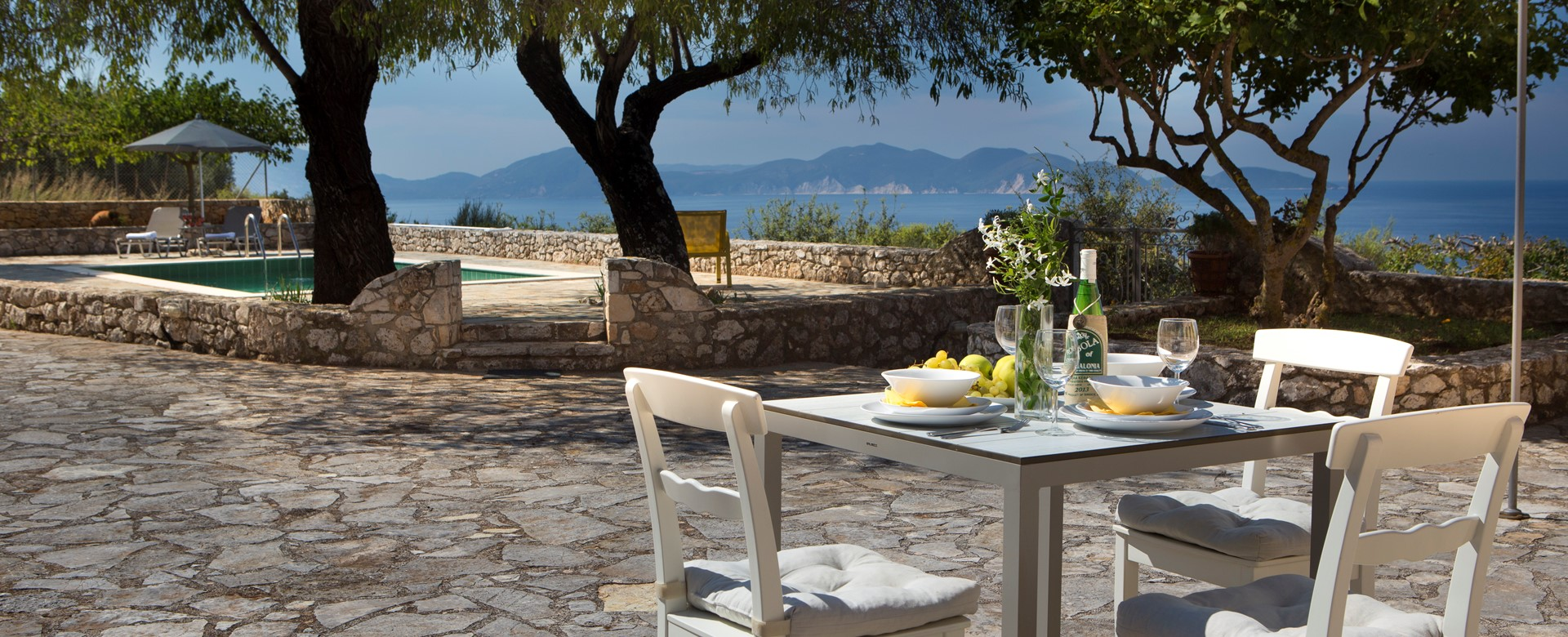 Light lunch in the sun with sea views outside Lemoni Cottage, Fiscardo, Kefalonia