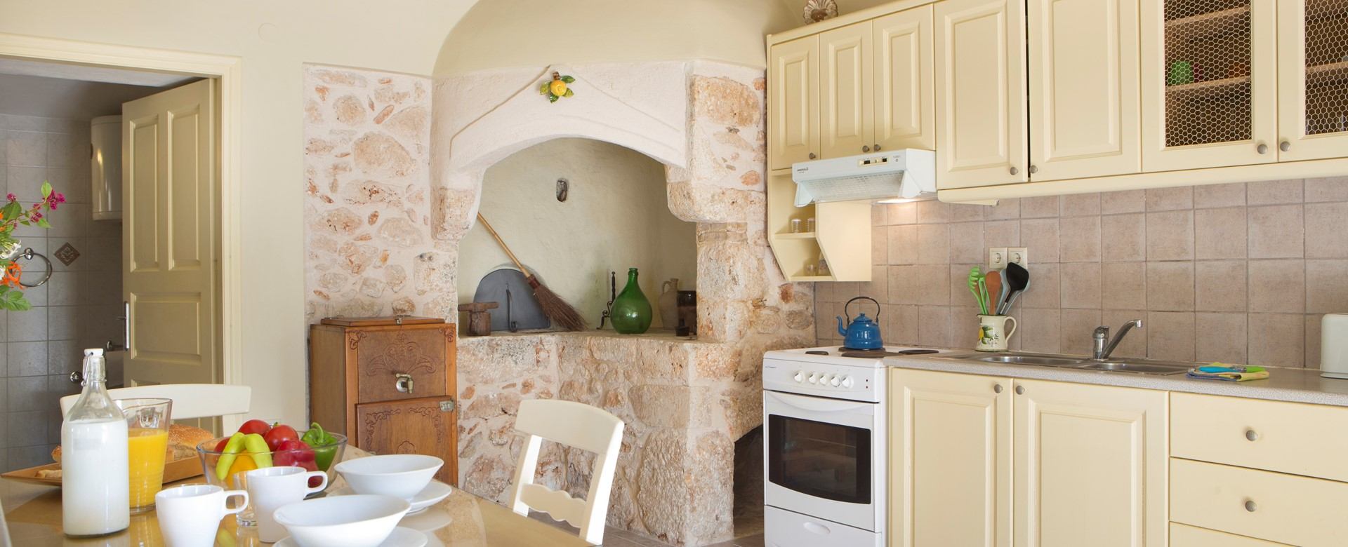 Dining and kitchen inside Lemoni Cottage, Fiscardo, Kefalonia