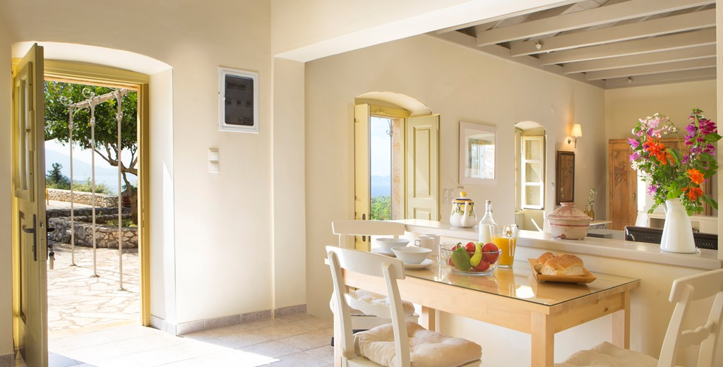 Dining with the doors open to let the view in at Lemoni Cottage, Fiscardo, Kefalonia