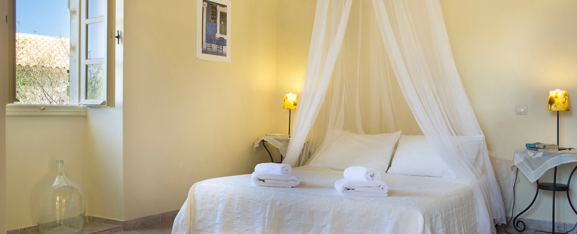 Master bedroom with king sized double bed perfect for a romantic holiday inside Lemoni Cottage, Fiscardo, Kefalonia