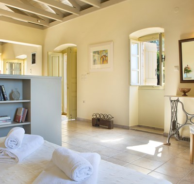 Open plan cottage interior with open ceiling space inside Lemoni Cottage, Fiscardo, Kefalonia