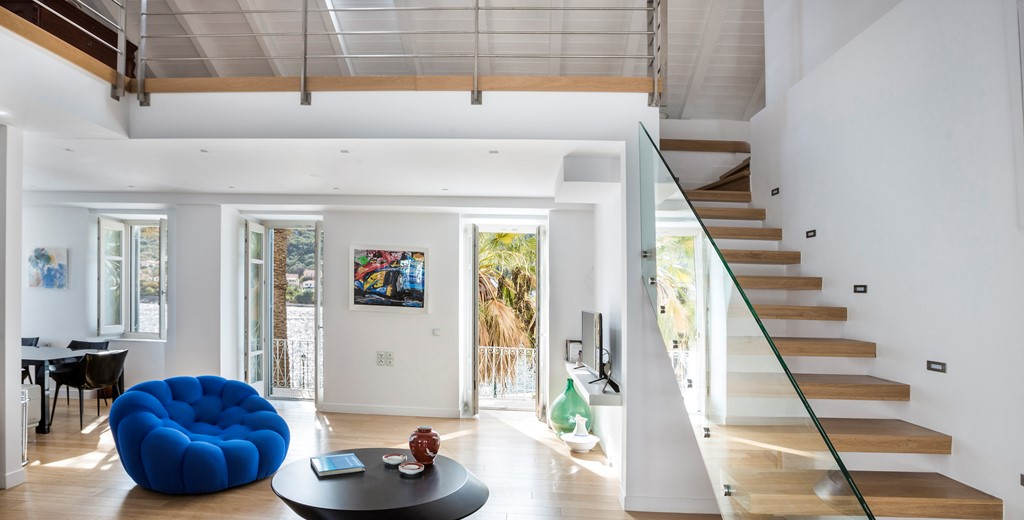 Mezanine and vaulted loft space with modern counter balance stairs inside Palm House Harbourfront Mansion, Agia Efimia, Kefalonia, Greek Islands