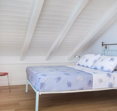Loft bedroom with double bed inside Palm House Harbourfront Mansion, Agia Efimia, Kefalonia, Greek Islands
