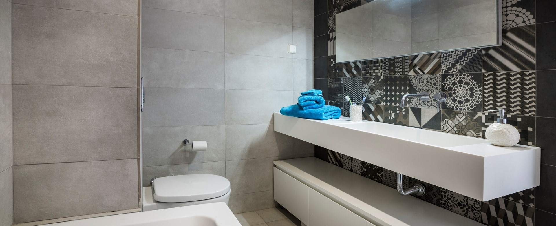 Modern fitted bathroom with bath and basin inside Palm House Harbourfront Mansion, Agia Efimia, Kefalonia, Greek Islands