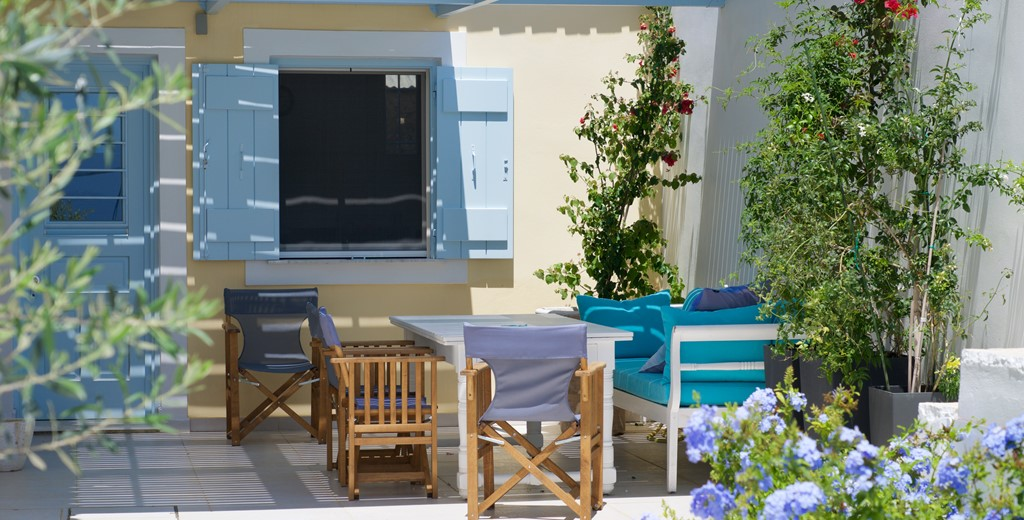 Outside dining under the pergola at Palm House Harbourfront Mansion, Agia Efimia, Kefalonia, Greek Islands