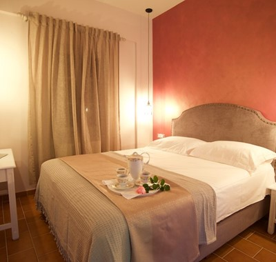 Large double bed with room to relax inside Magnolia Apartments, Fiscardo, Kefalonia, Greek Islands