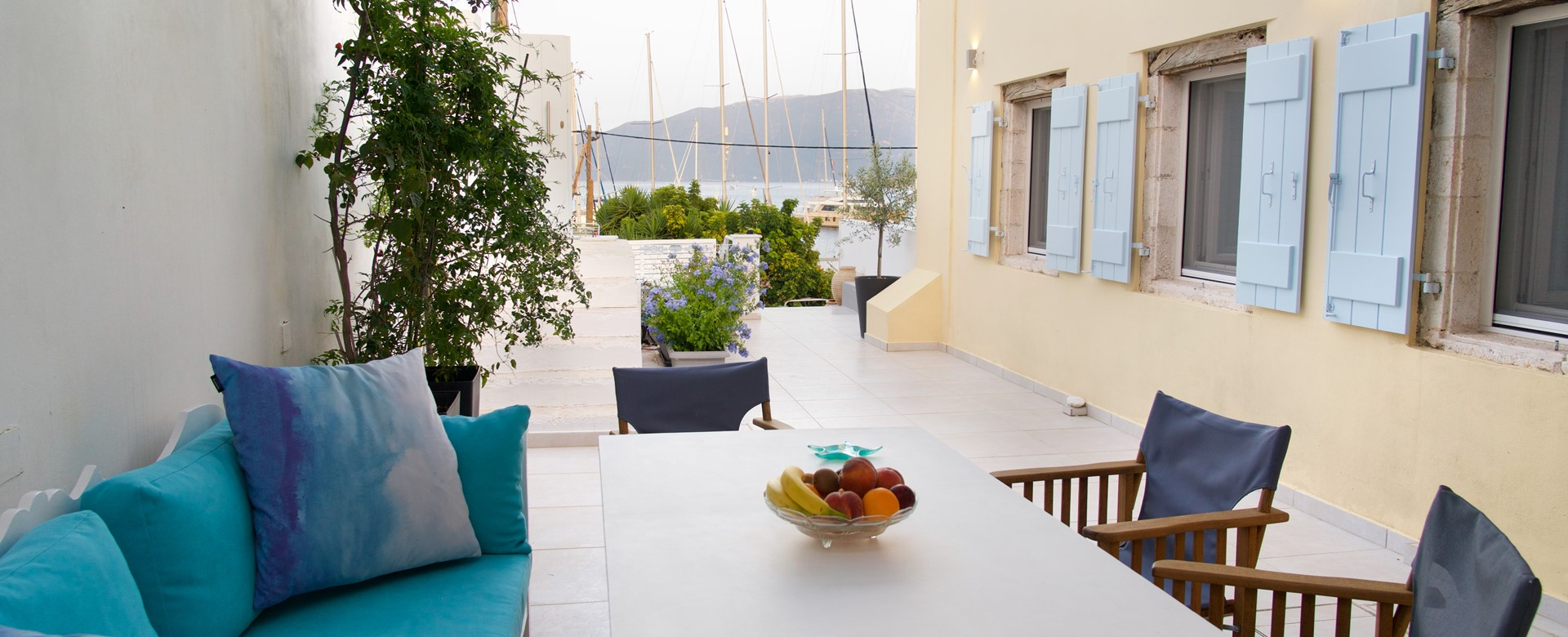 Private outside dining but still among the moored yachts of Palm House Harbourfront Mansion, Agia Efimia, Kefalonia, Greek Islands