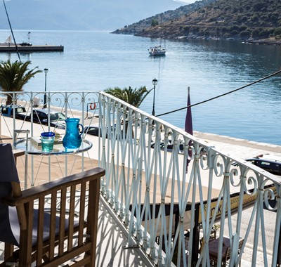 Watch the yachts and boats go out to sea in the morning while enjoying a morning coffee on the balcony of Palm House Harbourfront Mansion, Agia Efimia, Kefalonia, Greek Islands