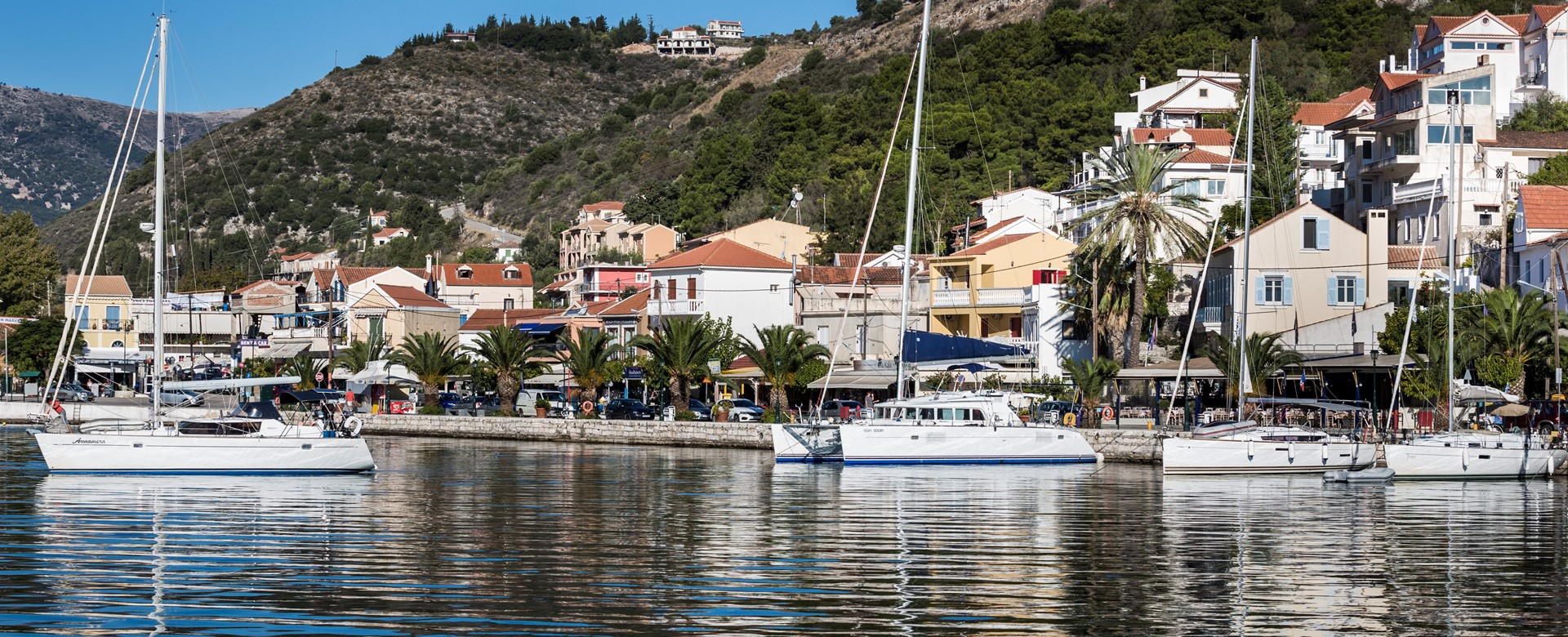 Looking back to Palm House Harbourfront Mansion from the harbour of Agia Efimia, Kefalonia, Greek Islands