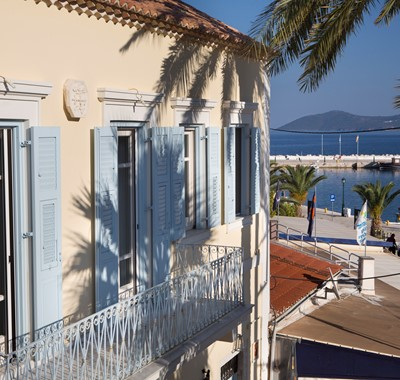 A view of the exterior balcony and views of Palm House Harbourfront Mansion, Agia Efimia, Kefalonia, Greek Islands