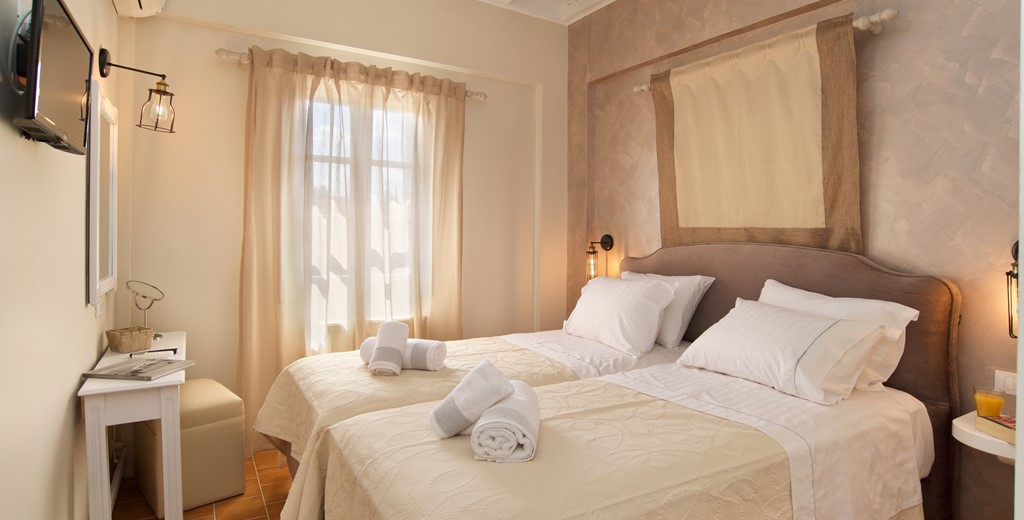 Beds and towels prepared for a relaxing holiday at Magnolia Apartments, Fiscardo, Kefalonia, Greek Islands