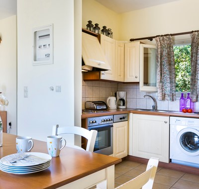 Fitted kitchen with washing machine has everything you need for a stay in Villa Cypress, Fiscardo, Kefalonia, Greek Islands