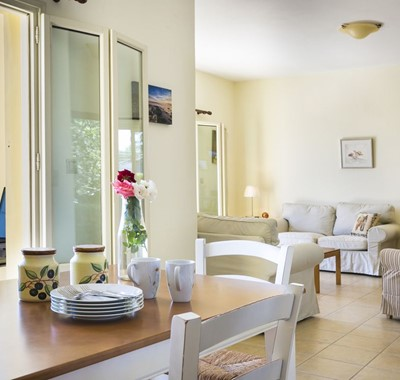Dining and living space inside Villa Cypress, Fiscardo, Kefalonia, Greek Islands