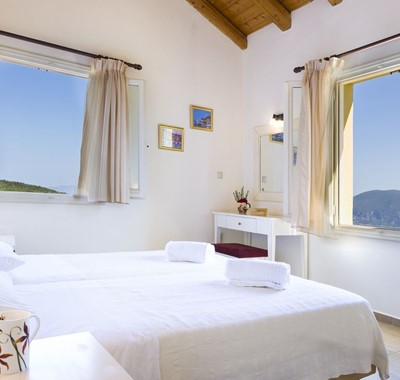 Bright clean and open bedroom space making the most of the views from Villa Cypress, Fiscardo, Kefalonia, Greek Islands