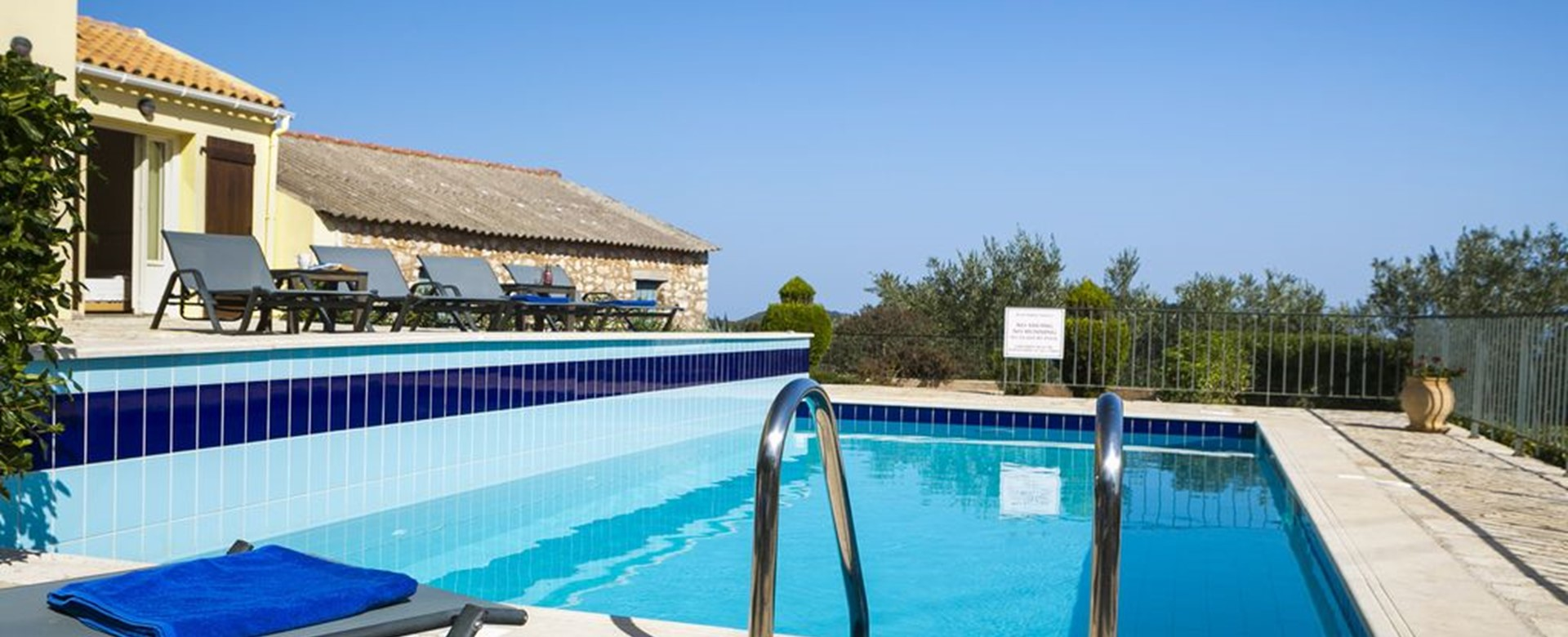 Cool off in the pool while sunbathing at Villa Cypress, Fiscardo, Kefalonia, Greek Islands