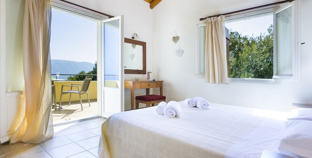 Spacious bedroom with king bed and private balcony in Villa Cypress, Fiscardo, Kefalonia, Greek Islands