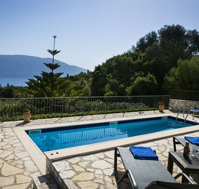 Sun beds on the terrace with pool surrounded by tree's and natural Kefalonia, Villa Cypress, Fiscardo, Kefalonia, Greek Islands