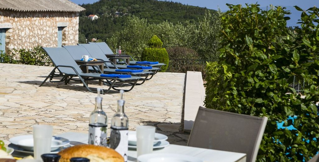 Take a break from the sunbathing with a mediteranean lunch by the pool at Villa Cypress, Fiscardo, Kefalonia, Greek Islands