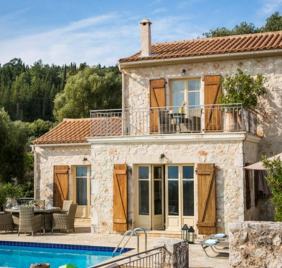 Rustic traditional stone Villa Pelagia with balcony and French doors in Fiscardo, Kefalonia, Greek Islands