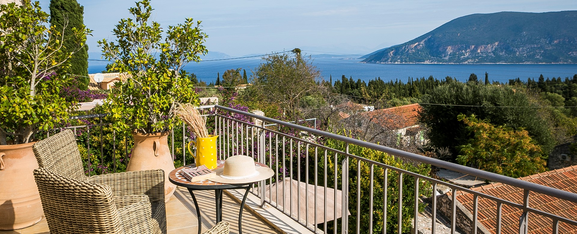 Enjoy a coffee or glass of wine as you unwind on holiday enjoying the views from the balcony of Villa Pelagia, Fiscardo, Kefalonia, Greek Islands