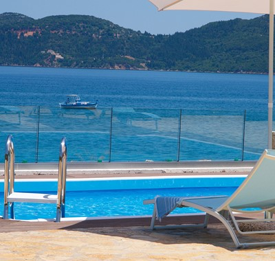 Watch the boats come and go from the pool side at Villa Frydi, Karavomilos, Kefalonia, Greek Islands