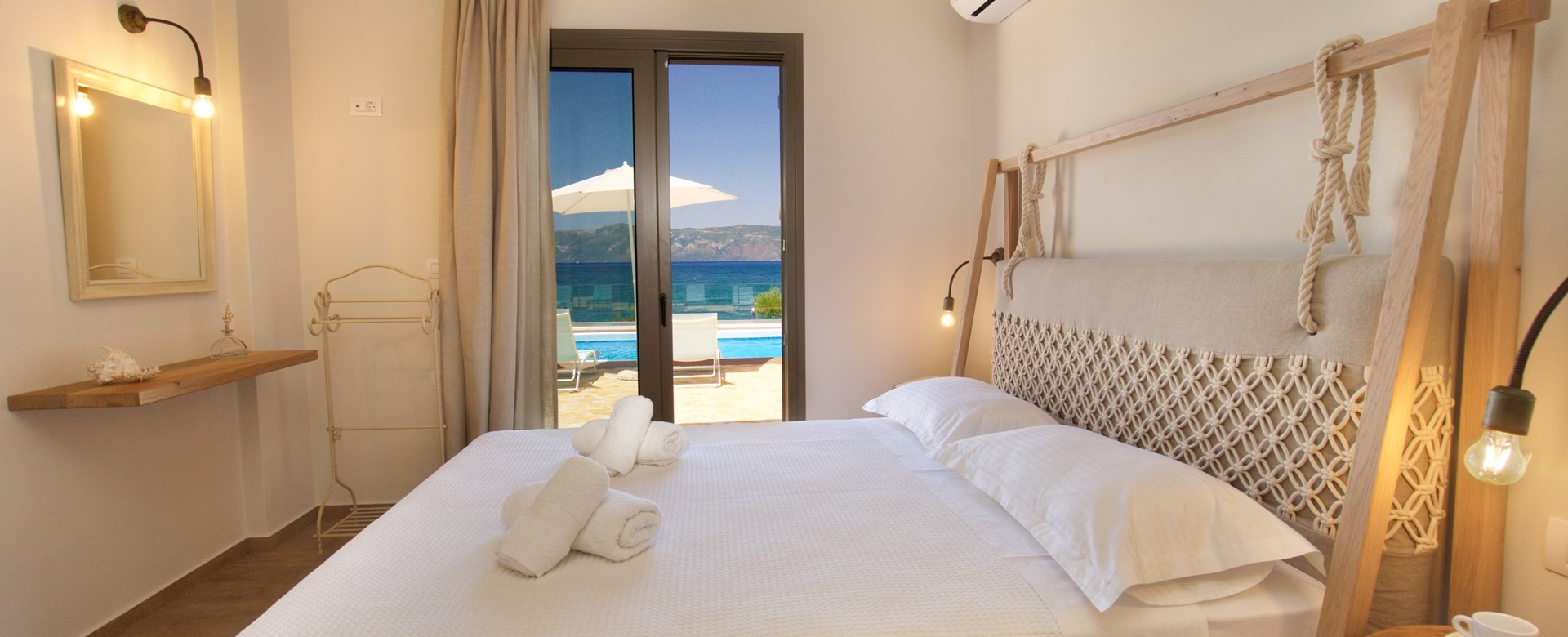 Comfortable large double bed with a view inside Villa Frydi, Karavomilos, Kefalonia, Greek Islands