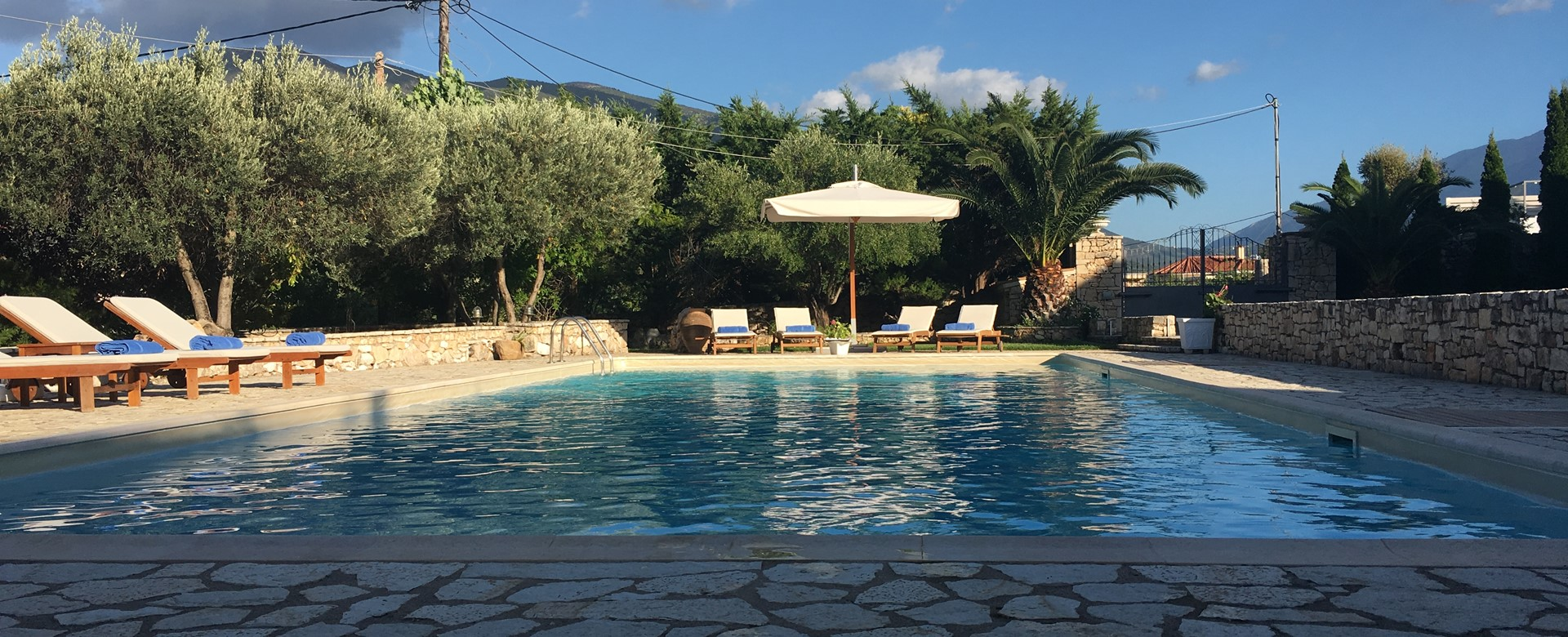 Evening sun around the pool at Casa Angela, Melissani Apartments, Karavomilos, Kefalonia, Greek Islands