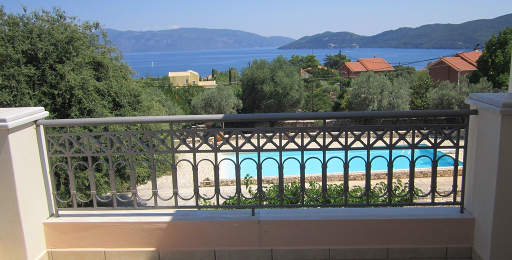 Balcony with a view of the pool, sea and coastline from Casa Angela, Melissani Apartments, Karavomilos, Kefalonia, Greek Islands