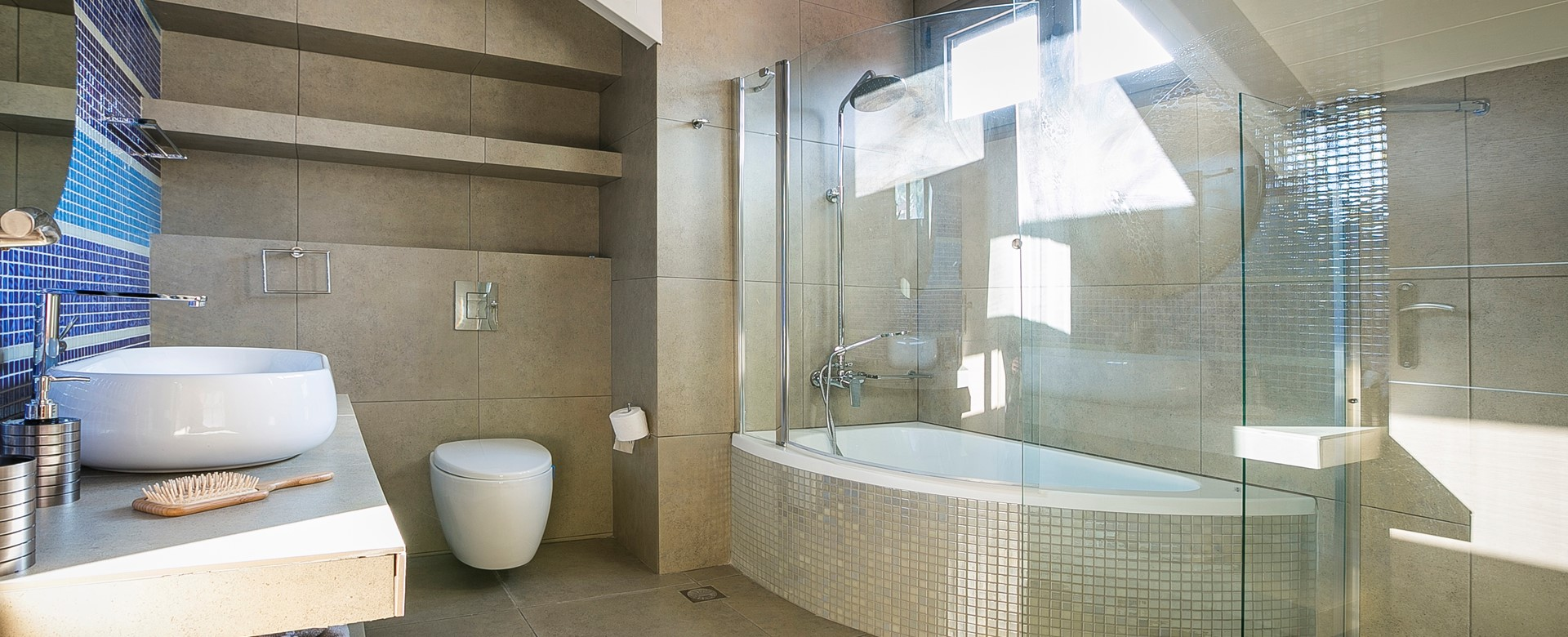 Corner bath with shower over and separate shower inside Marina Penthouse Apartment, Argostoli, Kefalonia, Greek Islands