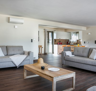 Open plan and spacious lounge dining and kitchen space inside Marina Penthouse Apartment, Argostoli, Kefalonia, Greek Islands
