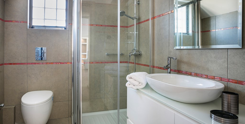 Bathroom with modern fittings and shower inside Marina Penthouse Apartment, Argostoli, Kefalonia, Greek Islands