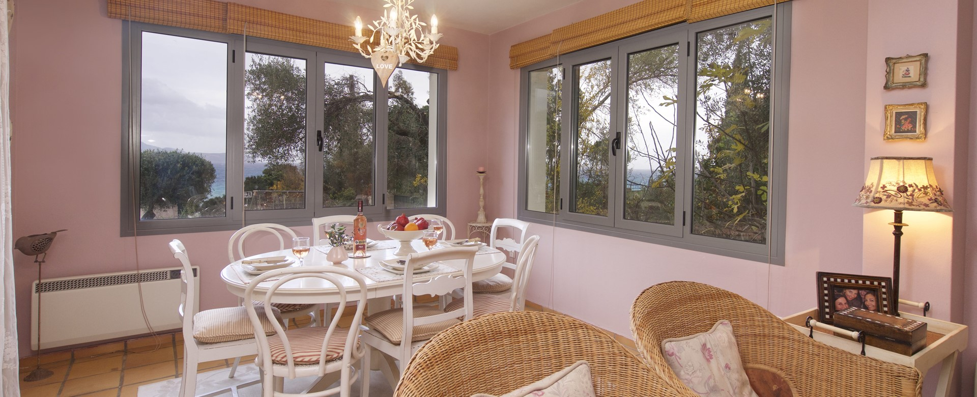 Family dining room with lovely views over the garden and sea at Villa Christianna, Pessada, Kefalonia, Greek Islands