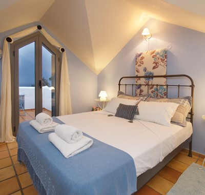 Double bed room with French doors onto private balcony at Villa Christianna, Pessada, Kefalonia, Greek Islands